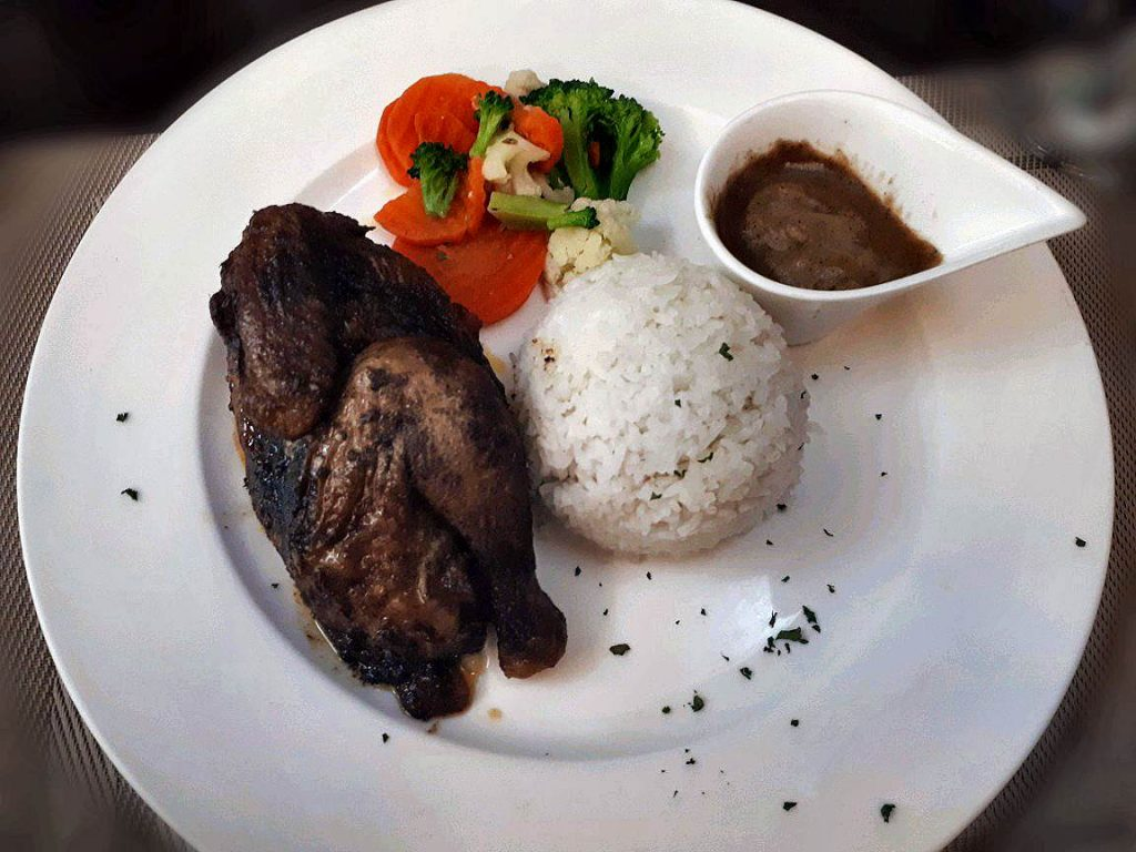 A delicious Roasted Chicken with rice and gravy found in the suite room in ayala cebu