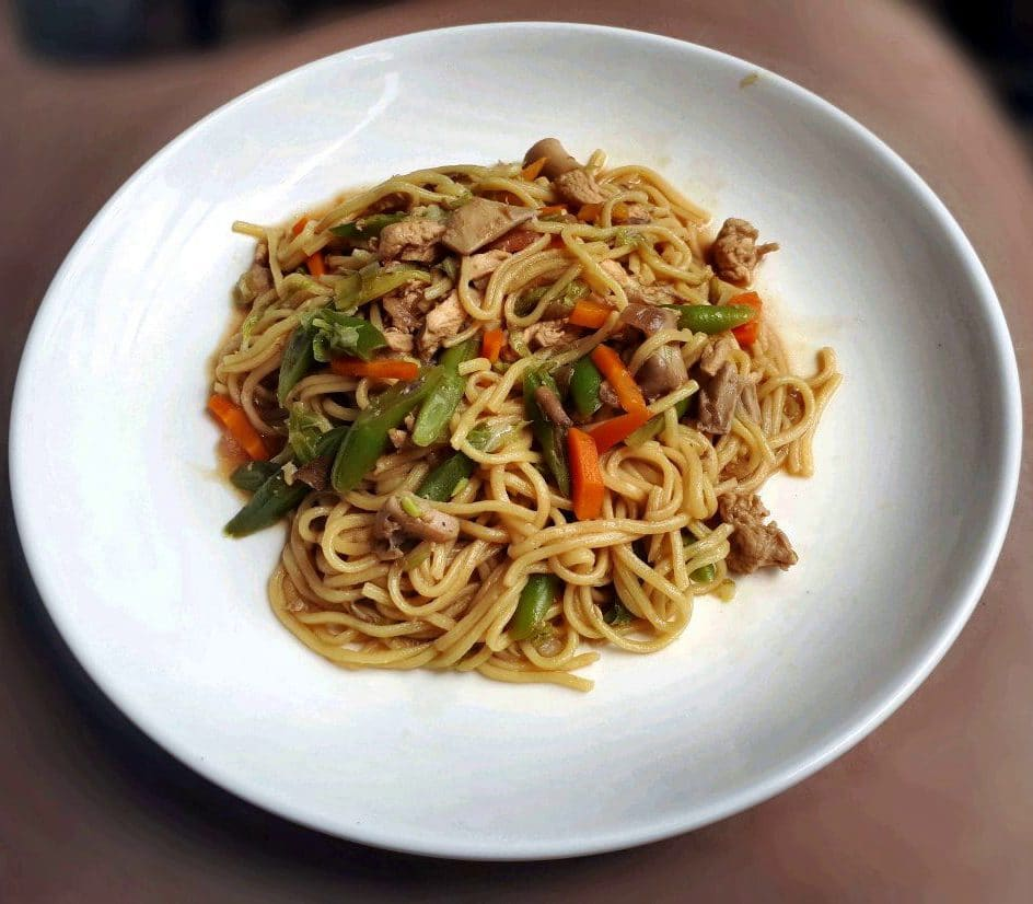 A filipino egg noodle dish called Chicken Pancit Canton