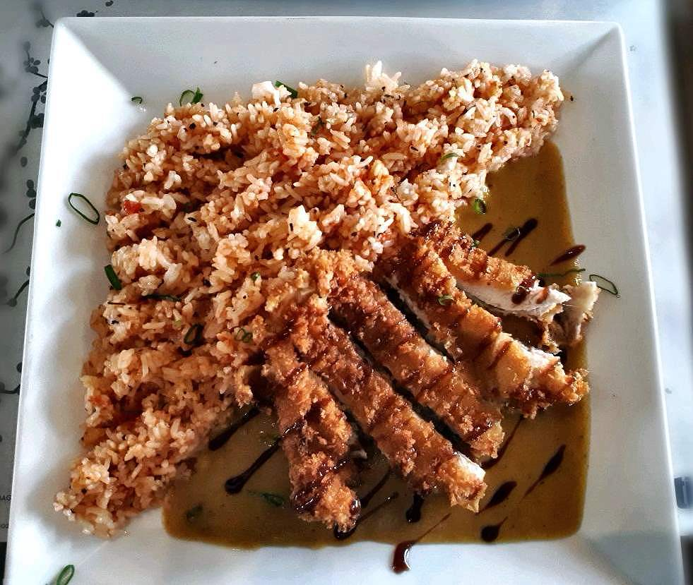 A chicken fillet with tomato rice and japanese curry called Chikita Katsu in Ilaputi