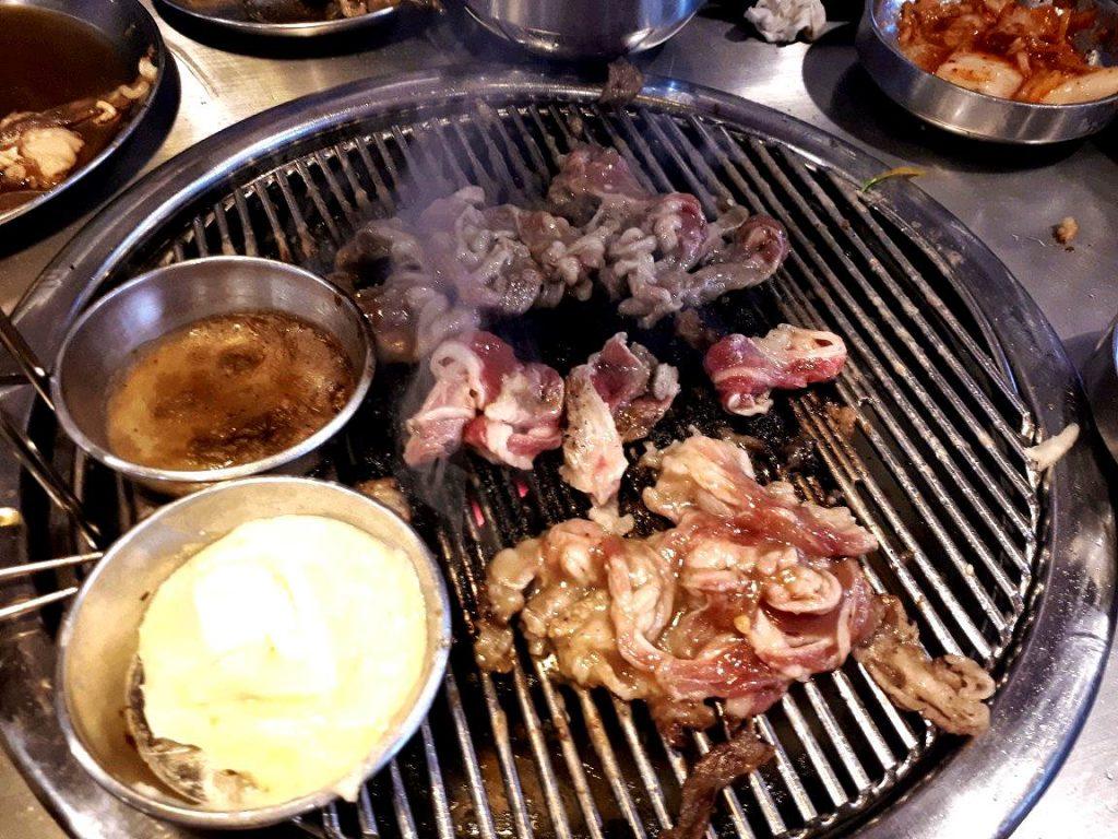 Grilling Korean beef in a Korean restaurant