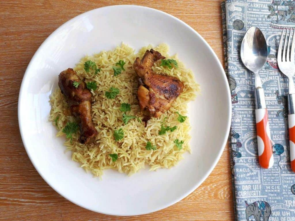 Chicken Majboos Recipe garnished with parsley