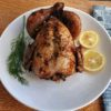 Roasted Herb Chicken with slices of lemon and dill