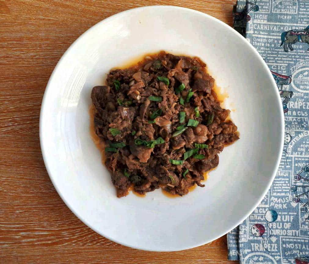 Spicy Korean Beef Stir Fry garnish with leaves of spring onion