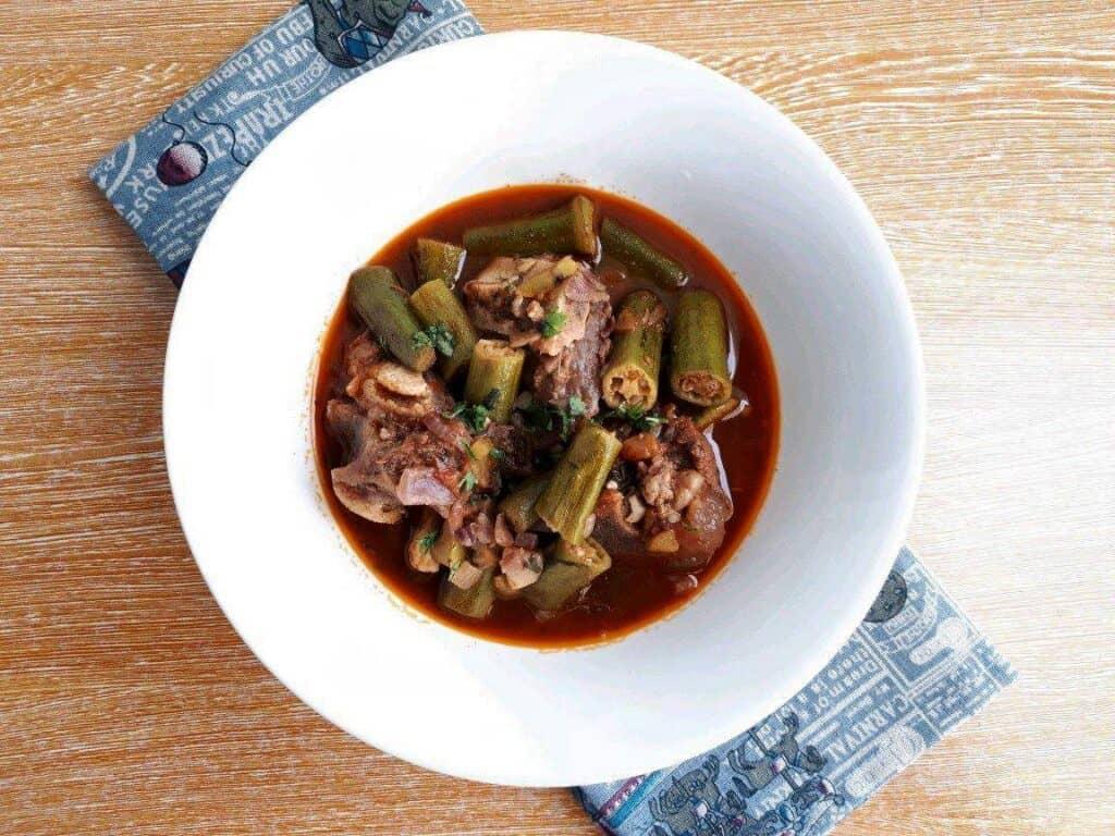 Beef Bamia Recipe (tomato okra soup) in a bowl.