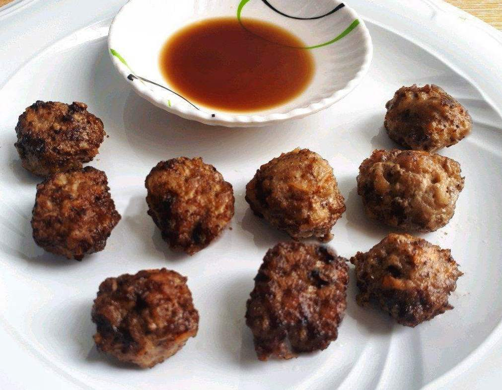 Beef Bola Bola meatball served with soy vinegar sauce in a plate