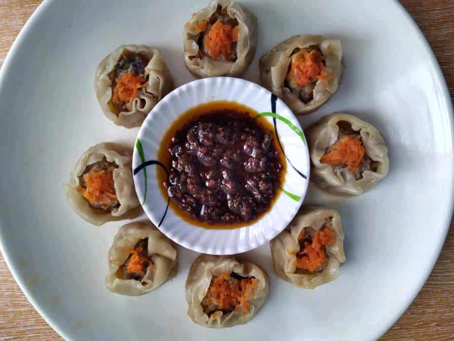 Beef Siomai Recipe garnished with grated carrots and serve with chili garlic oil.