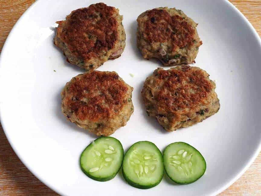 Chicken Kafta Patties with slices of cucumber in a plate