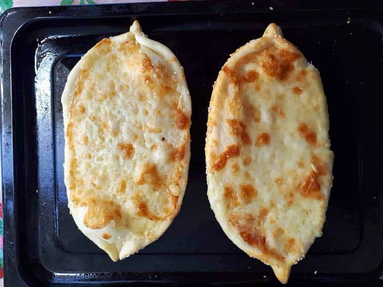 Turkish cheese flatbread called Cheese pide which is topped with Mozzarella and Cheddar Cheese