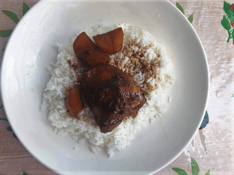 Filipino Chicken Adobo with Potatoes served with white rice in a plate