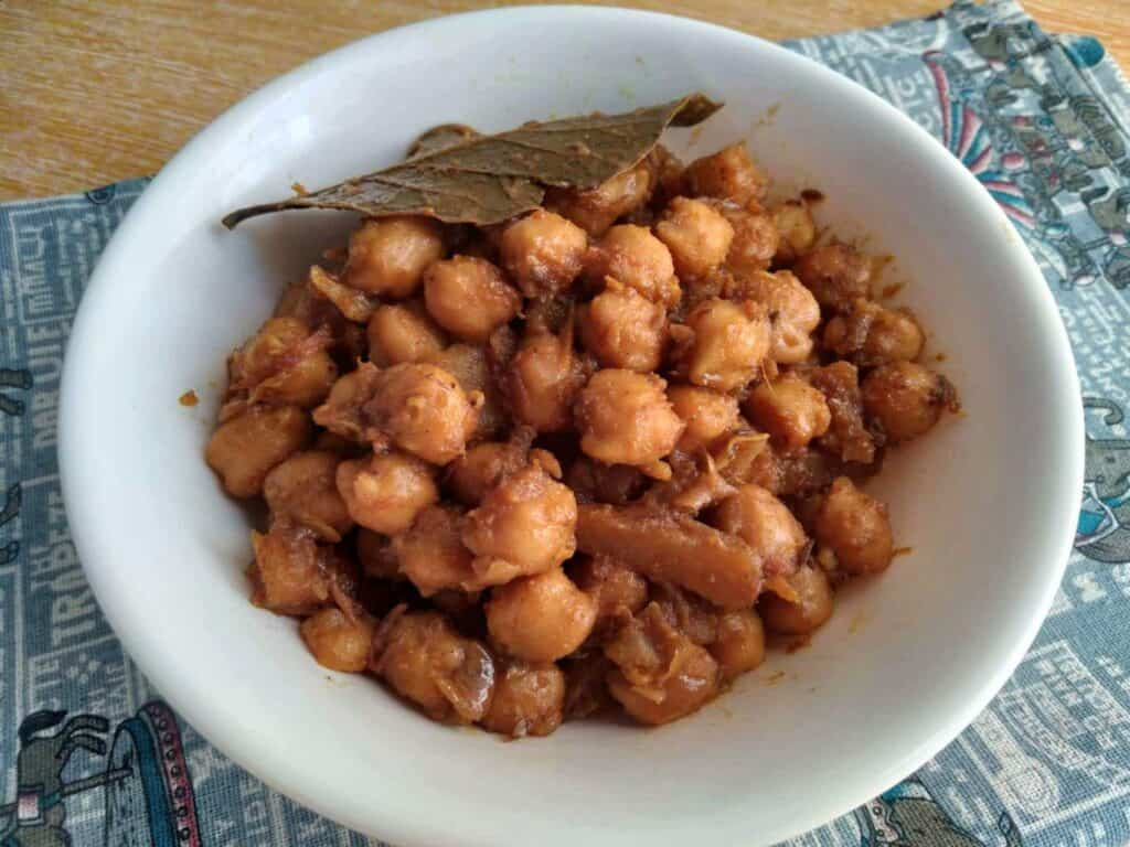 Aloo Chole mixed with chickpeas and potatoes with spices served in a plate