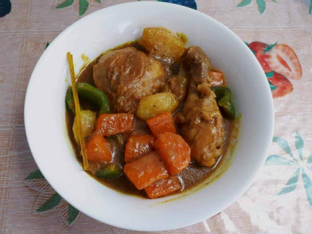 Filipino Chicken Curry mixed with carrots, bell pepper and potatoes braised in coconut milk.