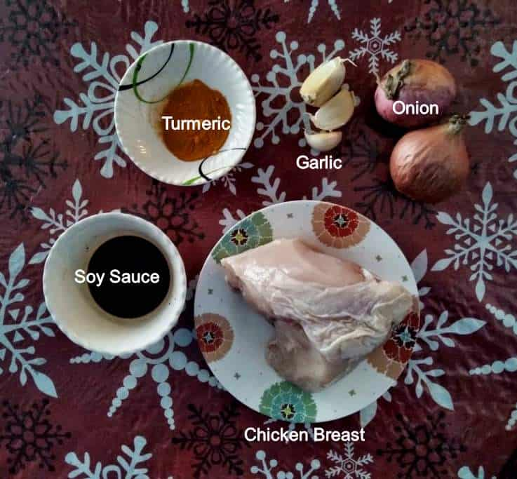 Recipe ingredients of Pastil Recipe which includes chicken breast, red onion, garlic, soy sauce and turmeric