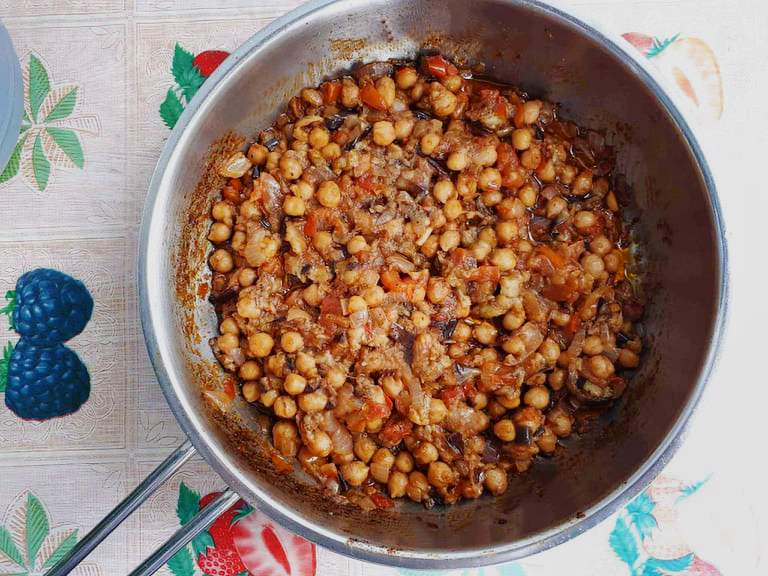 Lebanese Moussaka or Maghmour is a vegan eggplant recipe that is mixed with chickpeas, onion, garlic, and tomatoes.