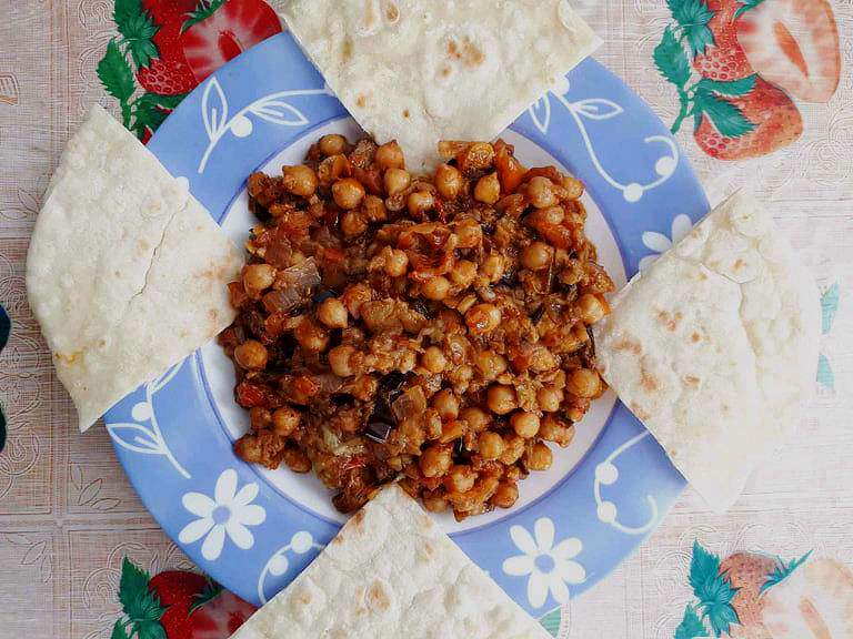 Lebanese Moussaka or Maghmour is a vegan eggplant recipe that is mixed with chickpeas, onion, garlic, and tomatoes which pairs well with pita bread.